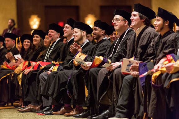 Houston College of Law graduates enjoy the commencement exercise in fall 2015.