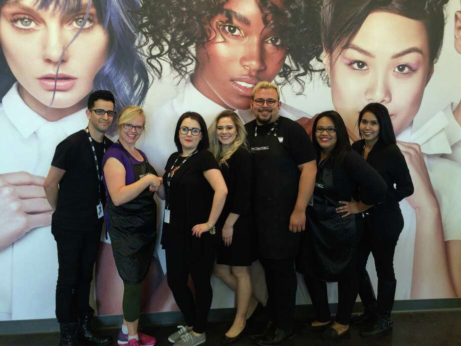 Representatives from Paul Mitchell the School in Webster and the Assistance League of the Bay Area planned hairstyle and makeup sessions for Operation Cinderella. Matthew Garza, left, Kathleen McNeil, Ashley Ratliff, Sarah Douglas, Mark Valladares, Desiry Sevilla and Jessie Solorio helped make the project a success.