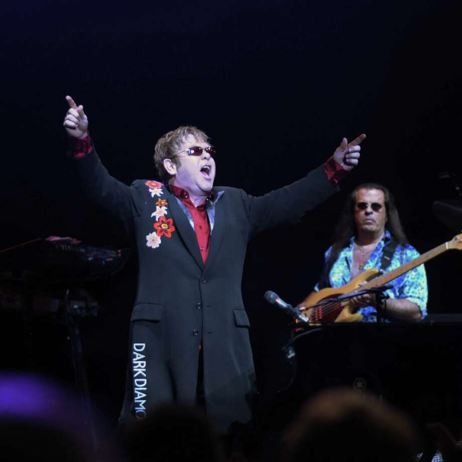 Elton John performs with his band during a concert at the Saratoga Performing Arts Center on Sunday night, Sept. 4, 2011 in Saratoga Springs.  (Paul Buckowski / Times Union) Photo: Paul Buckowski / 290604348844