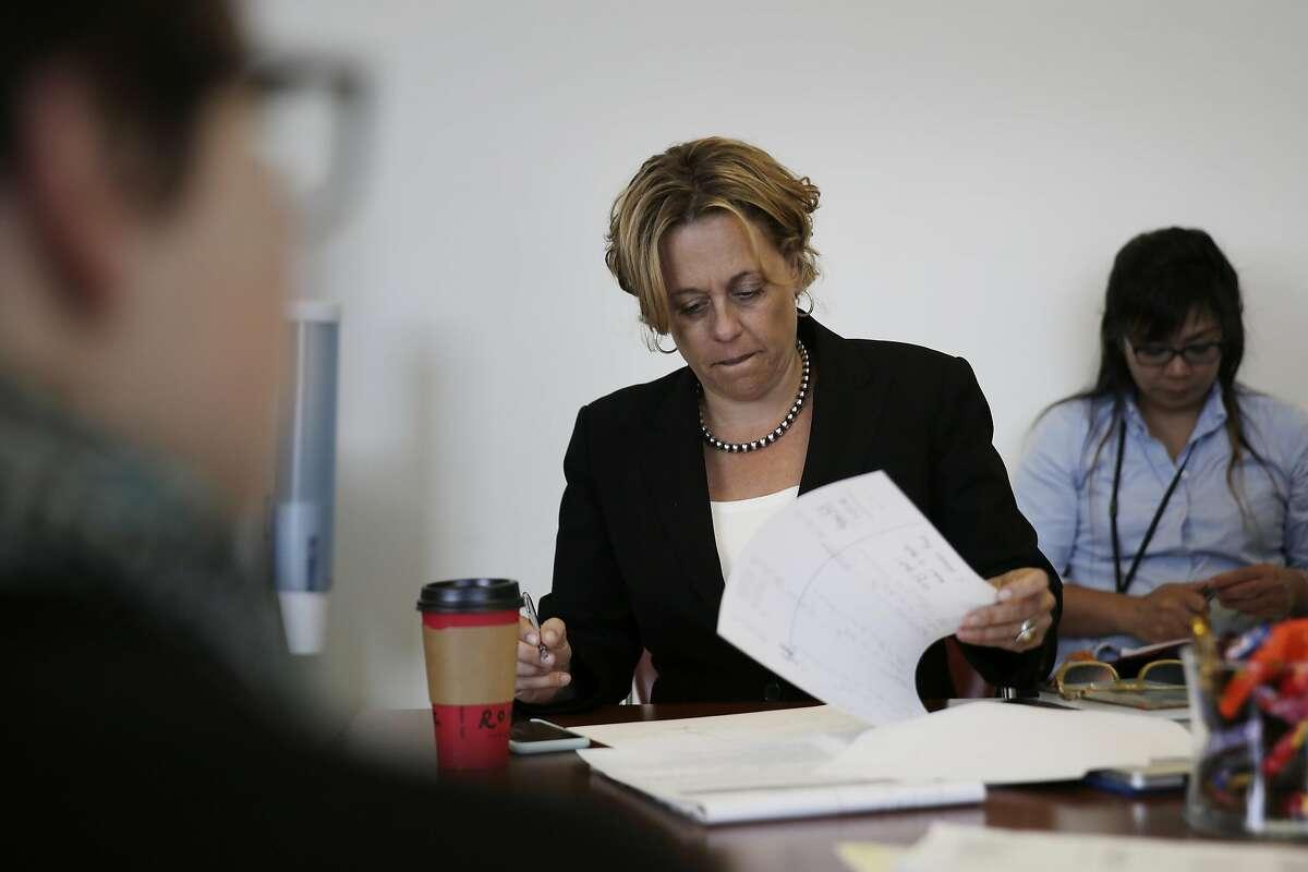 Deputy public defender Jennifer Johnson works during case conference before Behavioral Health Court on Friday, July 1, 2016 in San Francisco, California.
