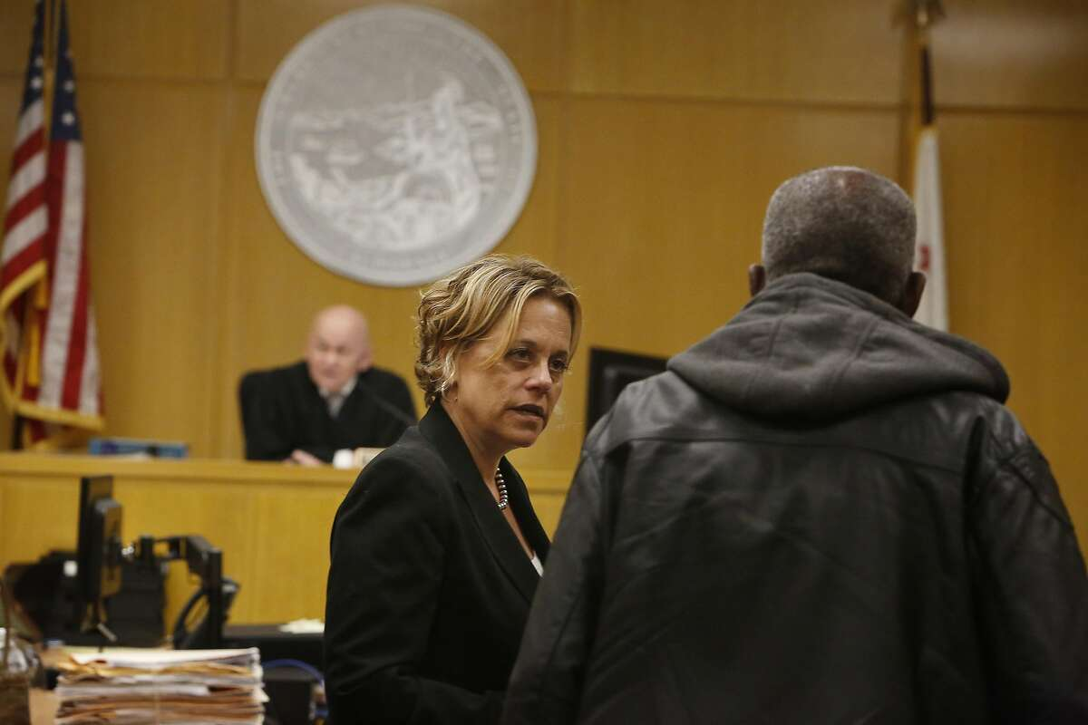 Deputy public defender Jennifer Johnson talks with a client during Behavioral Health Court on Friday, July 1, 2016 in San Francisco, California.