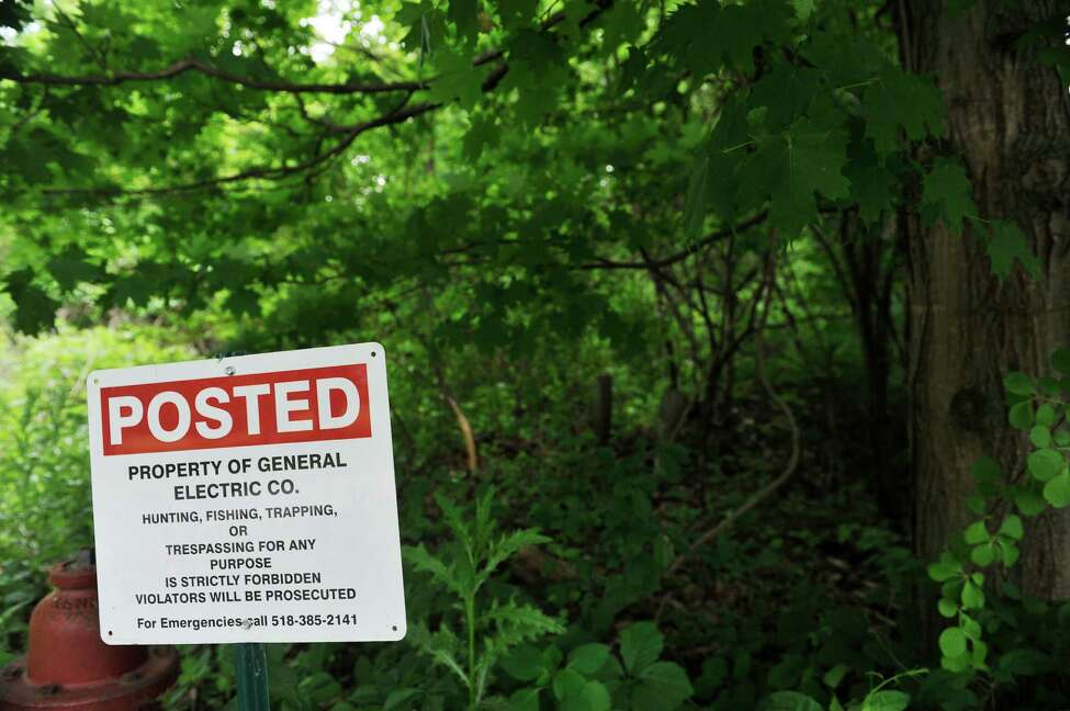 A sign is seen on the edge of GE property at the end of Old River Road on Wednesday, June 8, 2016, in Schenectady, N.Y. The contaminated landfills on the GE property are near this area. (Paul Buckowski / Times Union)