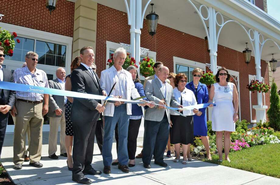 Dignitaries cut a ribbon to mark the official opening of Saratoga Casino Hotel Wednesday July 6, 2016 in Saratoga Springs, NY.  (John Carl D'Annibale / Times Union) Photo: John Carl D'Annibale / 20037202A
