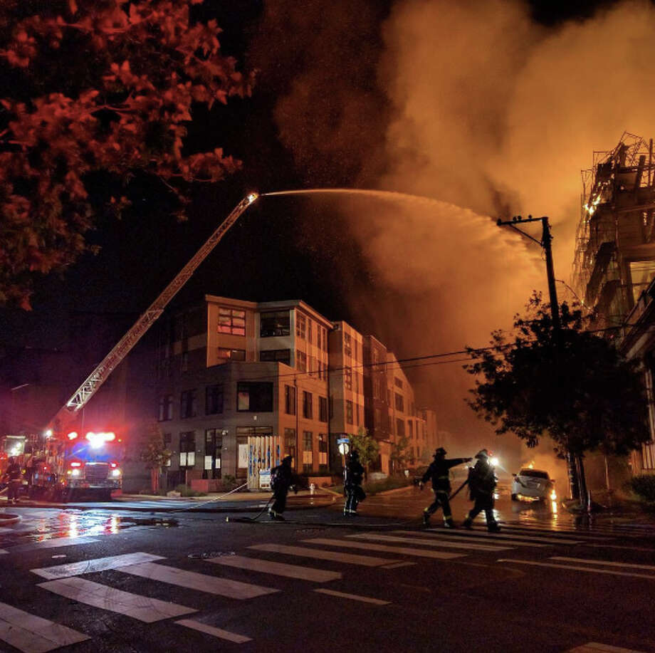 A 6-alarm inferno tore through a 5-story structure and spread to nearby  homes along San Pablo Boulevard in Emeryville early Wednesday. Photo: Instagram / @agiriley