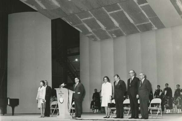 Dignitaries stand during a dedication for the Saratoga Performing Arts Center June, 17, 1966, at Spa State Park in Saratoga Springs, N.Y. Gov. Nelson Rockefeller, center, and Mrs. Rockefeller, Margaretta Large Fitler, center left. Gene Robb, former Times Union publisher, is at the podium. (Times Union archive)