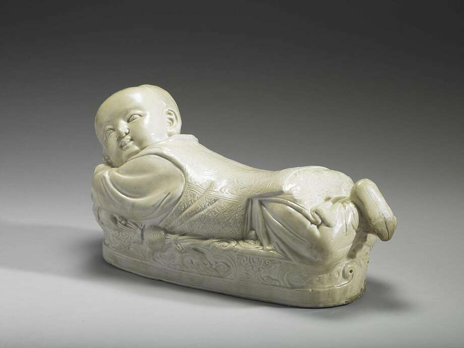 "The ceramic ""Pillow in the Shape of a Recumbent Boy"" is from the Northern Song Dynasty (960-1127). Photo: National Palace Museum, Taipei / Courtesy Asian Art Museum"