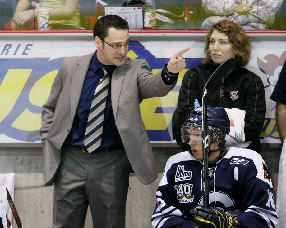 Shawinigan Cataractes coach Eric Veilleux talks to his players during the game against the Cape Breton Screaming Eagles at the Shawinigan Amphitheatre on Jan. 30, 2009 in Shawinigan, Quebec. Photo: Richard Wolowicz /Getty Images / 2009 Richard Wolowicz