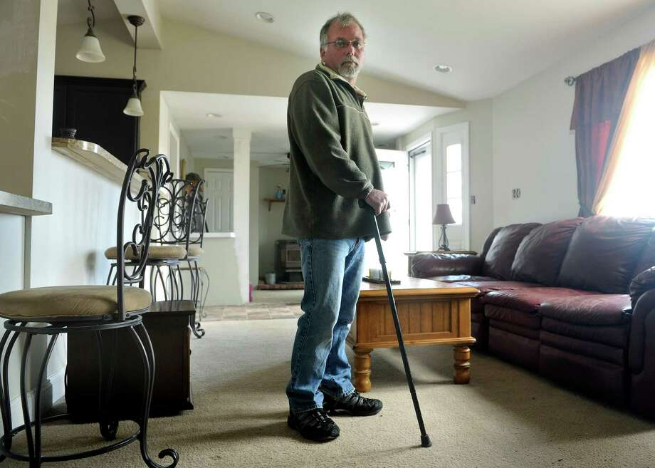 Richard Tesiero, who lives in Fort Johnson, hasn't been able to work full time since he came down with a mysterious illness. He has to use a cane because of his health problems. (Paul Buckowski / Times Union) Photo: PAUL BUCKOWSKI / 10035812A
