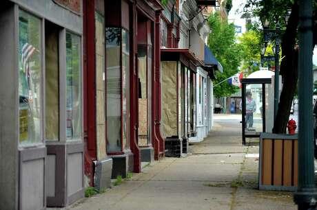 A view of empty storefronts in downtown Gloversville. (Paul Buckowski / Times Union) Photo: PAUL BUCKOWSKI / 40036919A