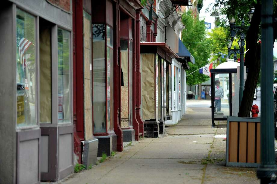 A view of empty storefronts in downtown Gloversville. (Paul Buckowski / Times Union) Photo: PAUL BUCKOWSKI / 40036919A