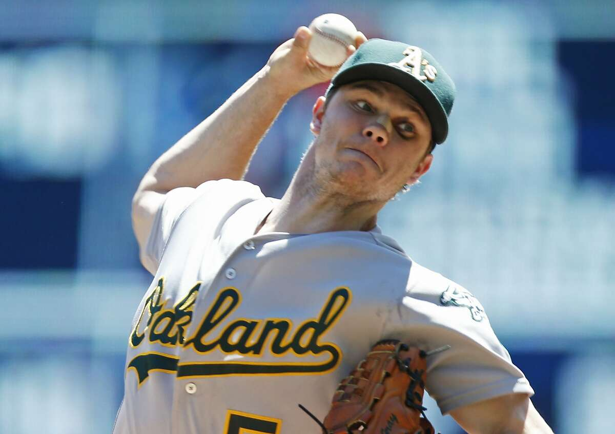 Oakland Athletics pitcher Sonny Gray throws against the Minnesota Twins in the first inning of a baseball game Wednesday, July 6, 2016, in Minneapolis. (AP Photo/Jim Mone)