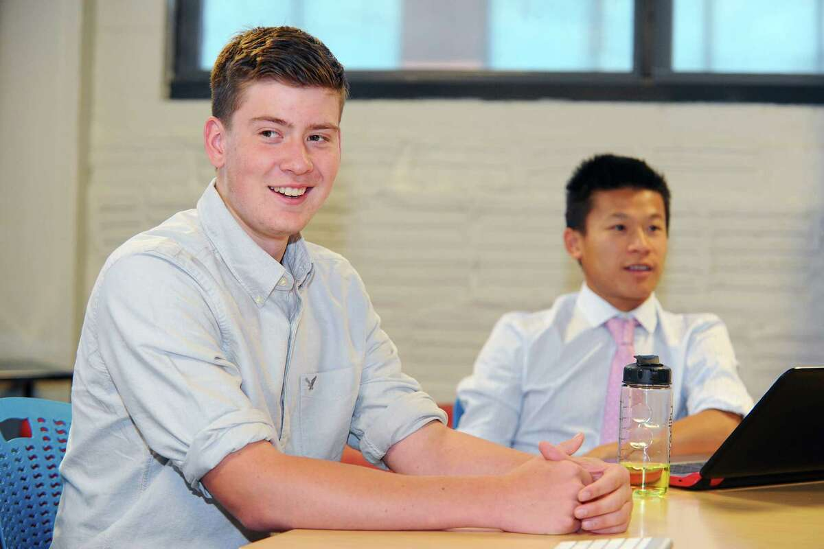 Jake Dardis, left, smiles while discussing his new internship at Comradity thanks to the Mayor's Youth Employment Program. Photographed on Thursday, June 30, 2016.
