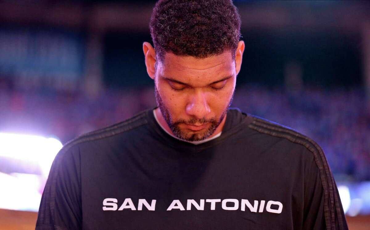 Spurs' Tim Duncan stands during the national anthem before Game 6 in the Western Conference semifinals against the Oklahoma City Thunder on May 12, 2016 at Chesapeake Energy Arena.