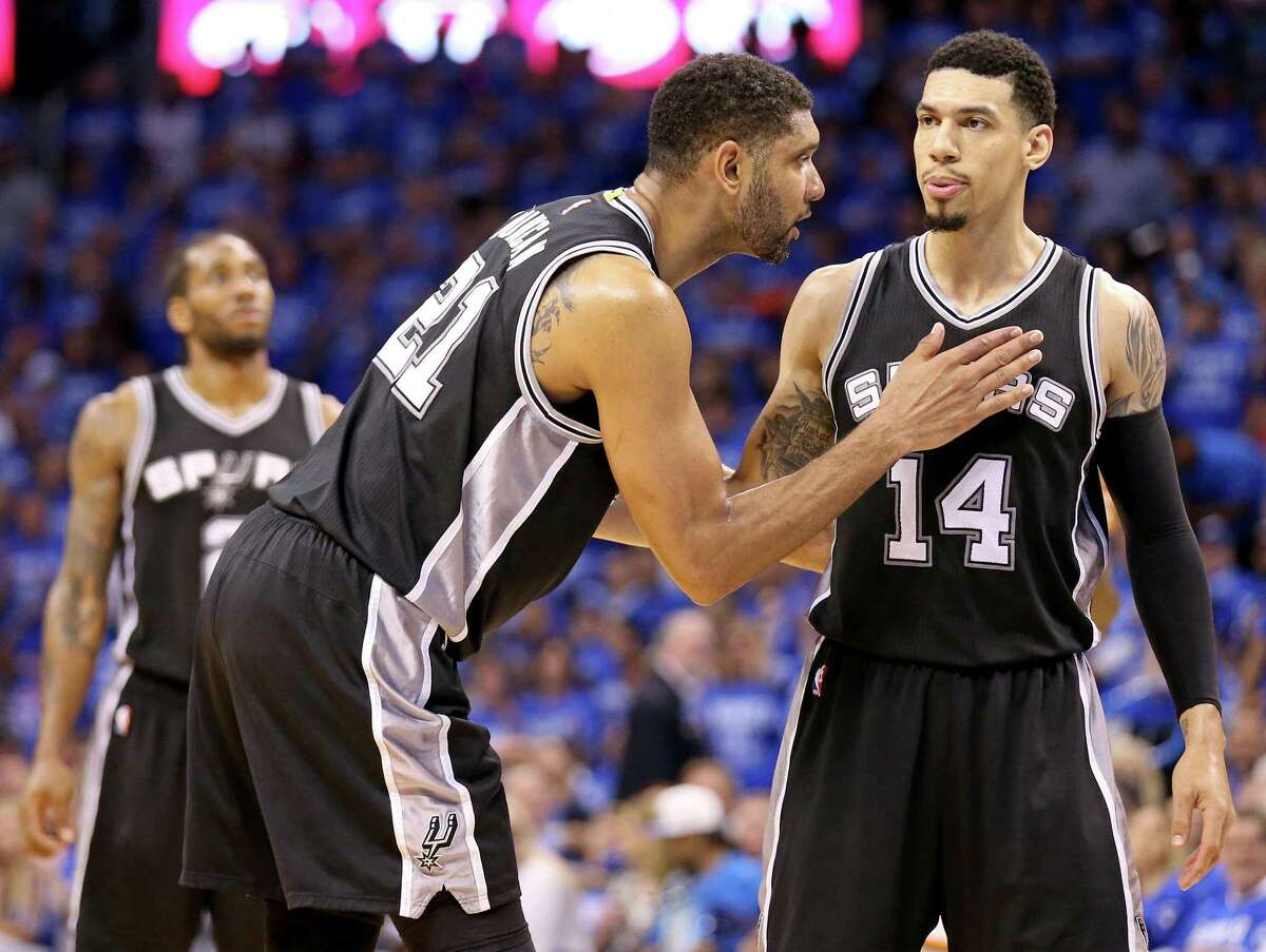 Spurs' Tim Duncan talks with Danny Green as Green shoots a free throw during second half action of Game 6 in the Western Conference semifinals against the Thunder Thursday on May 12, 2016 at Chesapeake Energy Arena in Oklahoma City.