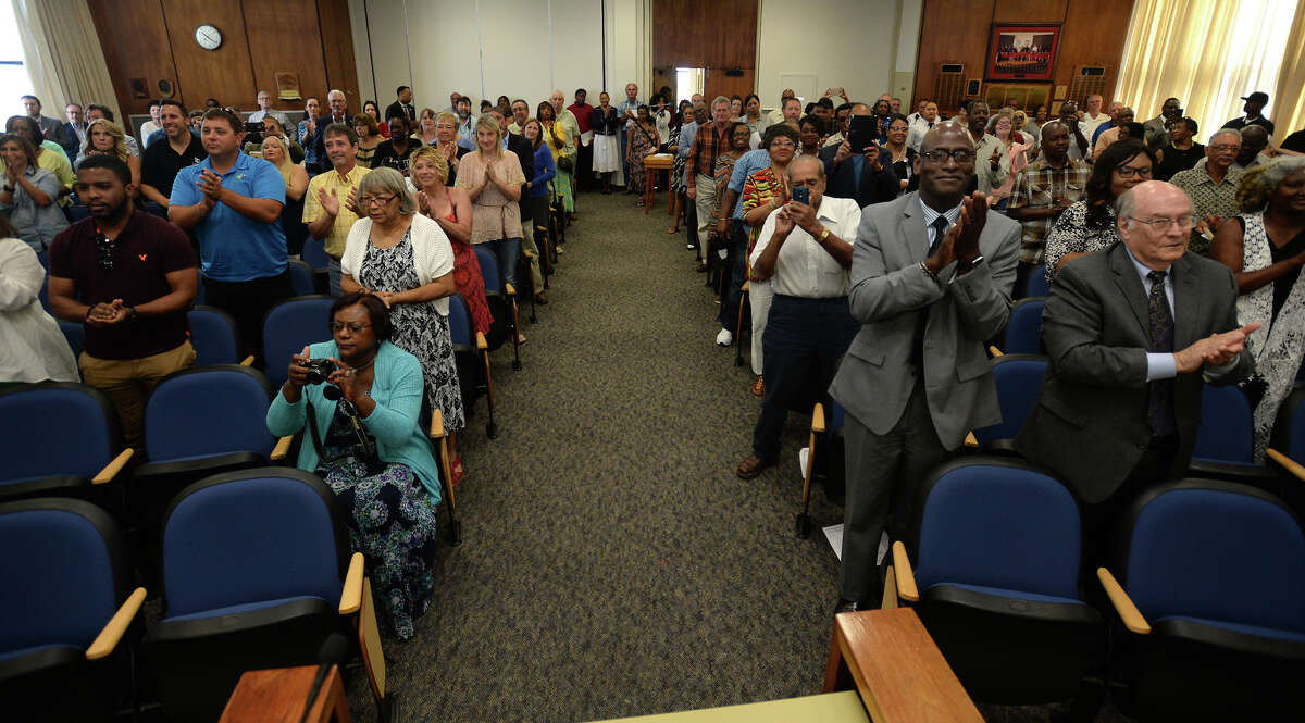 Supporters, residence and local business operators stand and applaud Derrick Freeman after being sworn in as Port Arthur's newest mayor. Photo taken Wednesday, July 06, 2016 Guiseppe Barranco/The Enterprise