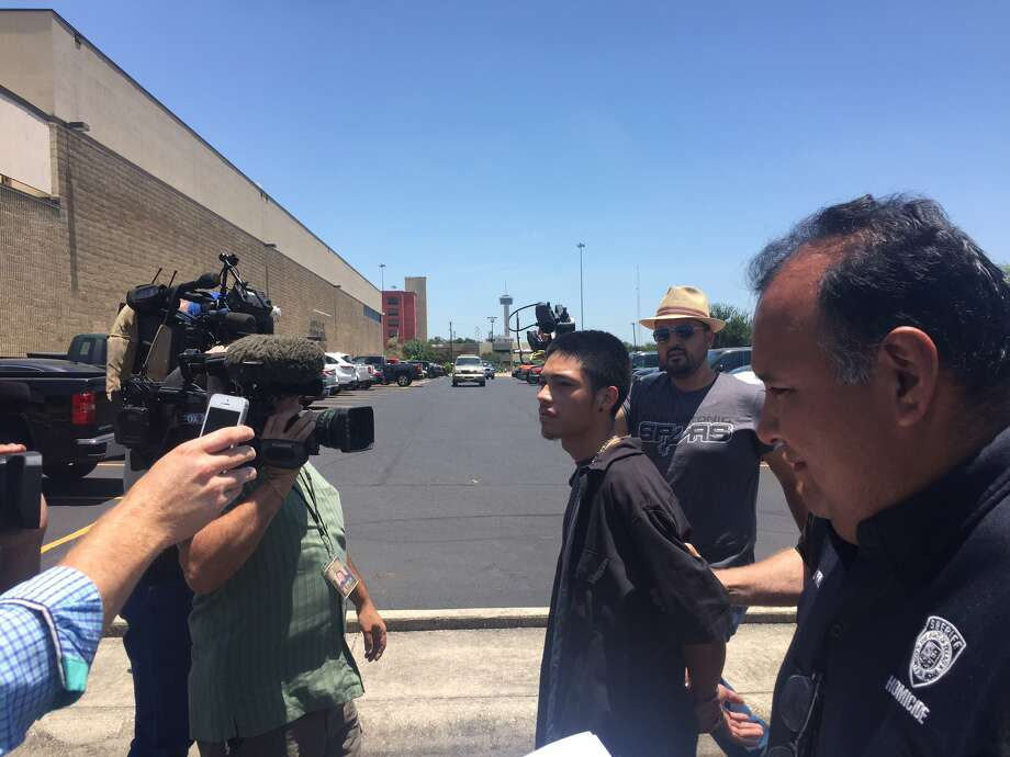 Bexar County Sheriff's deputies walk Jonathan Moreno, 19, to the Bexar County Jail. Moreno was arrested on July 6 on a charge of capital murder. Photo: Bexar County Sheriff's Office