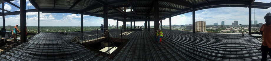 Construction workers work on the flooring of a penthouse floor at The River Oaks at 3433 Wertheimer Road on Tuesday, July 5, 2016, in Houston. Photo: Elizabeth Conley, Houston Chronicle / © 2016 Houston Chronicle