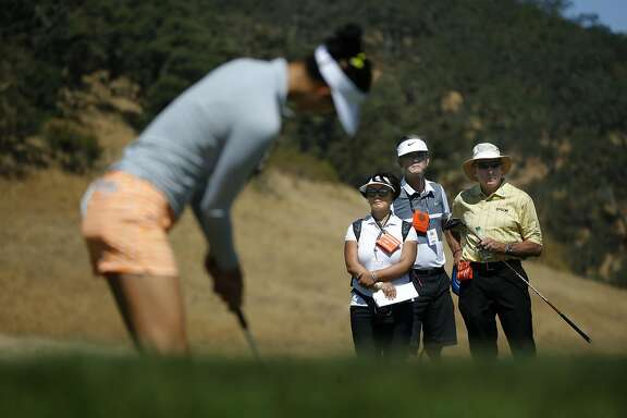 Michelle Wie putting on the 14th hole under the watchful eyes of her parents Bo and B. J. Wie and also golf coach David Leadbetter, (right) during her practice round in preparation for the 2016 US Women's Open Championship at CordeValle in San Martin, California, on Wed. July 6, 2016.