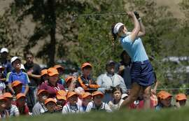 World number one amateur Hannah O'Sullivan tess off on the 8th hole under the watchful eyes of children in the First Tee Junior Golf program during her practice round in preparation for the 2016 US Women's Open Championship at CordeValle in San Martin, California, on Wed. July 6, 2016.