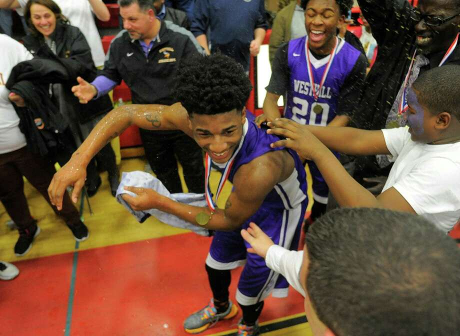 Westhill Parish Rowell is showered with gatoraide after being selected as the tournament MVP. Westhill defeated Danbury 72-61 in an FCIAC basketball championship at Fairfield Warde High School in Fairfield, Conn. on  March 3, 2016. Photo: Matthew Brown / Hearst Connecticut Media / Stamford Advocate
