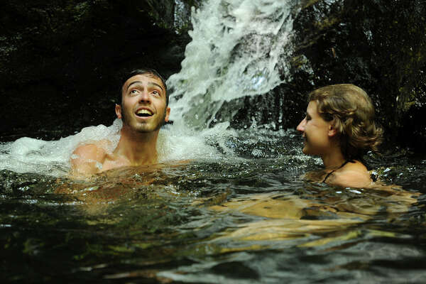 Friends Branden Colasante and Sara Maturo, of Westbrook, cool off with a swim by the waterfall at Indian Well State Park in Shelton, Conn. on Wednesday, July 6, 2016.