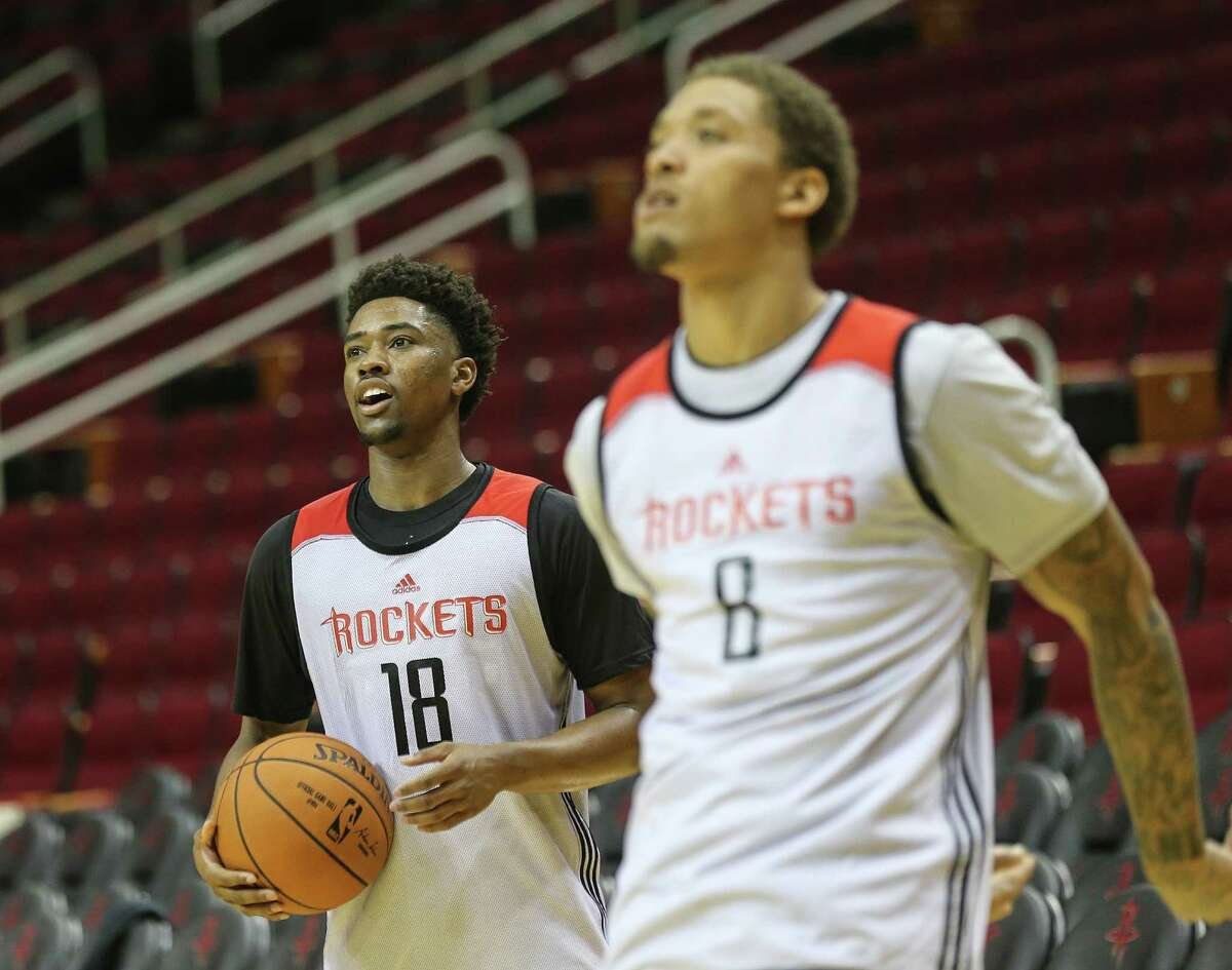 Members of Houston Rockets' Samsung NBA Summer League including Isaiah Taylor (18) and Michael Beasley (8) practice at the Toyota Center before heading to Las Vegas on Wednesday, July 6, 2016, in Houston.