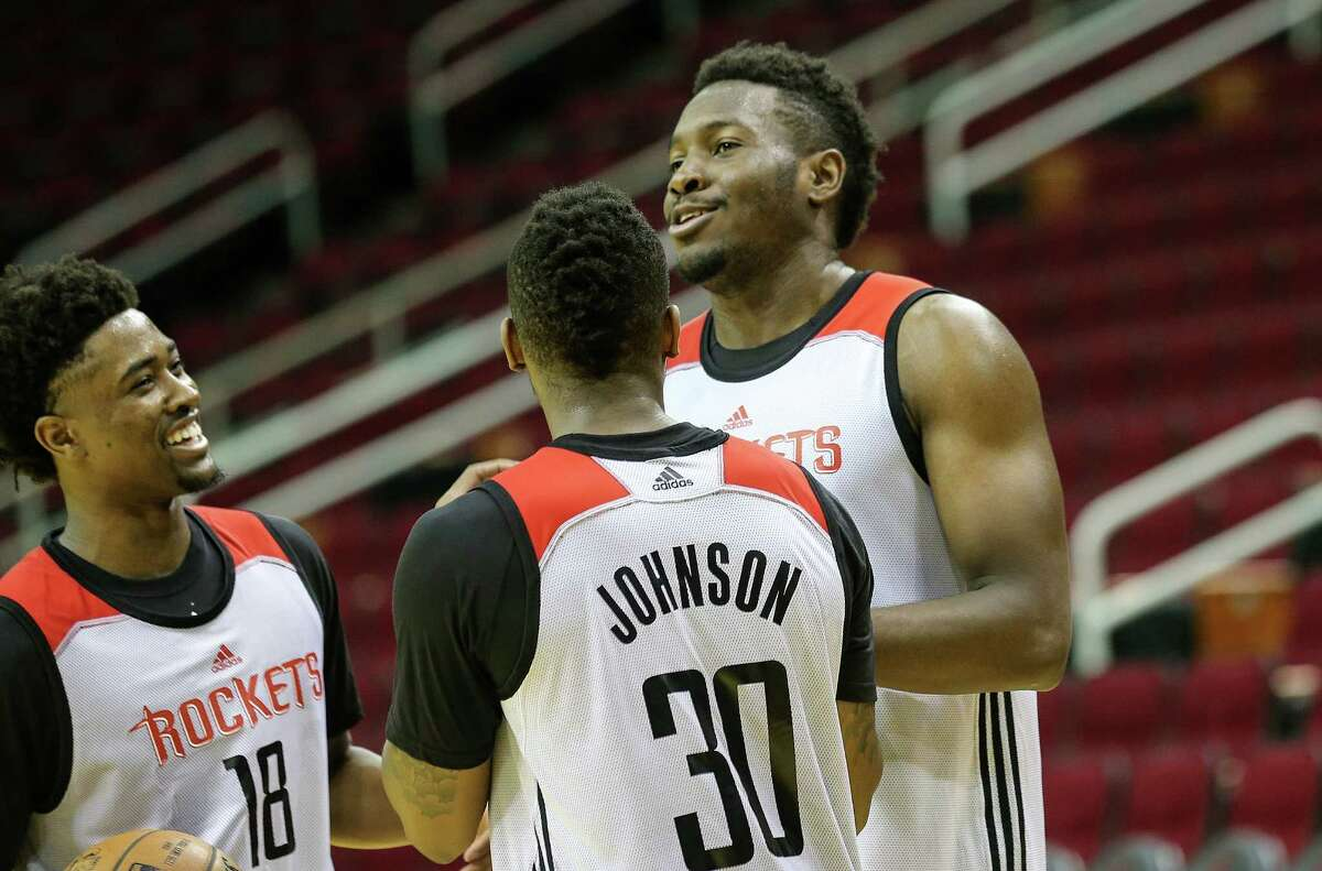 Isaiah Taylor (8), Chinanu Onuaku (21) and Melvin Johnson (3) joke around after practice with the Houston Rockets' Samsung NBA Summer League practice at the Toyota Center before heading to Las Vegas on Wednesday, July 6, 2016, in Houston.