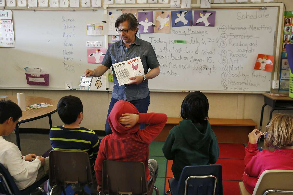 Special Education teacher George Keller gets his student's attention as he reads them a book during the last class of the extended school year for special education students at Sunset Elementary School July 6, 2016 in San Francisco, Calif.