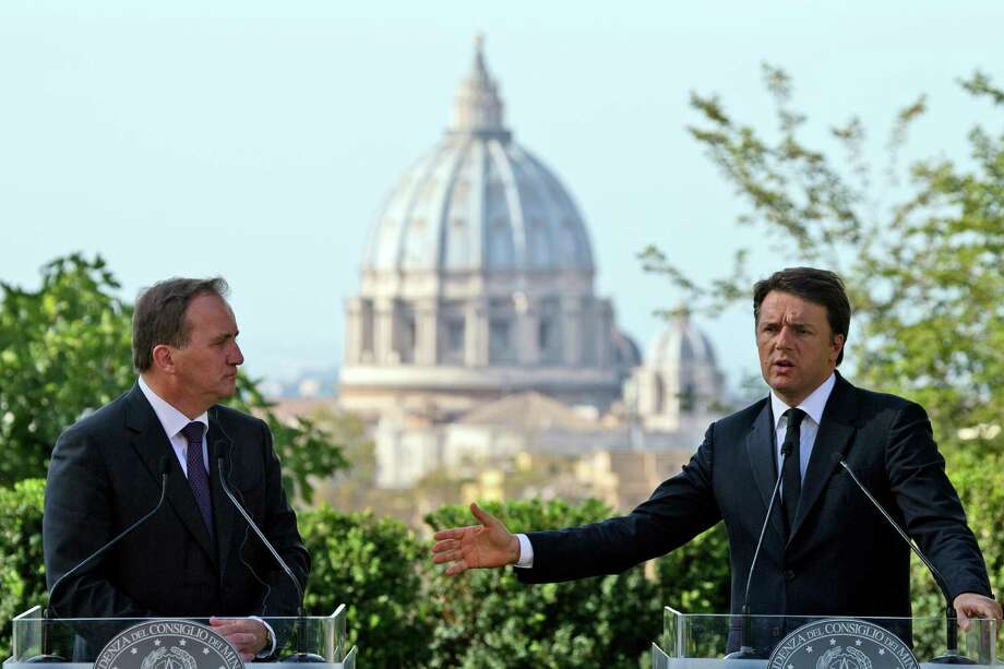 Italian Premier Matteo Renzi, right, and Swedish Prime Minister Stefan Lofven, backdropped by the St. Peter's Basilica, talk to journalists during a press conference at the end of their meeting, at Rome's Villa Panphilii, Wednesday, July 6, 2016.  (AP Photo/Andrew Medichini) ORG XMIT: AJM117 Photo: Andrew Medichini / Copyright 2016 The Associated Press. All rights reserved. This m