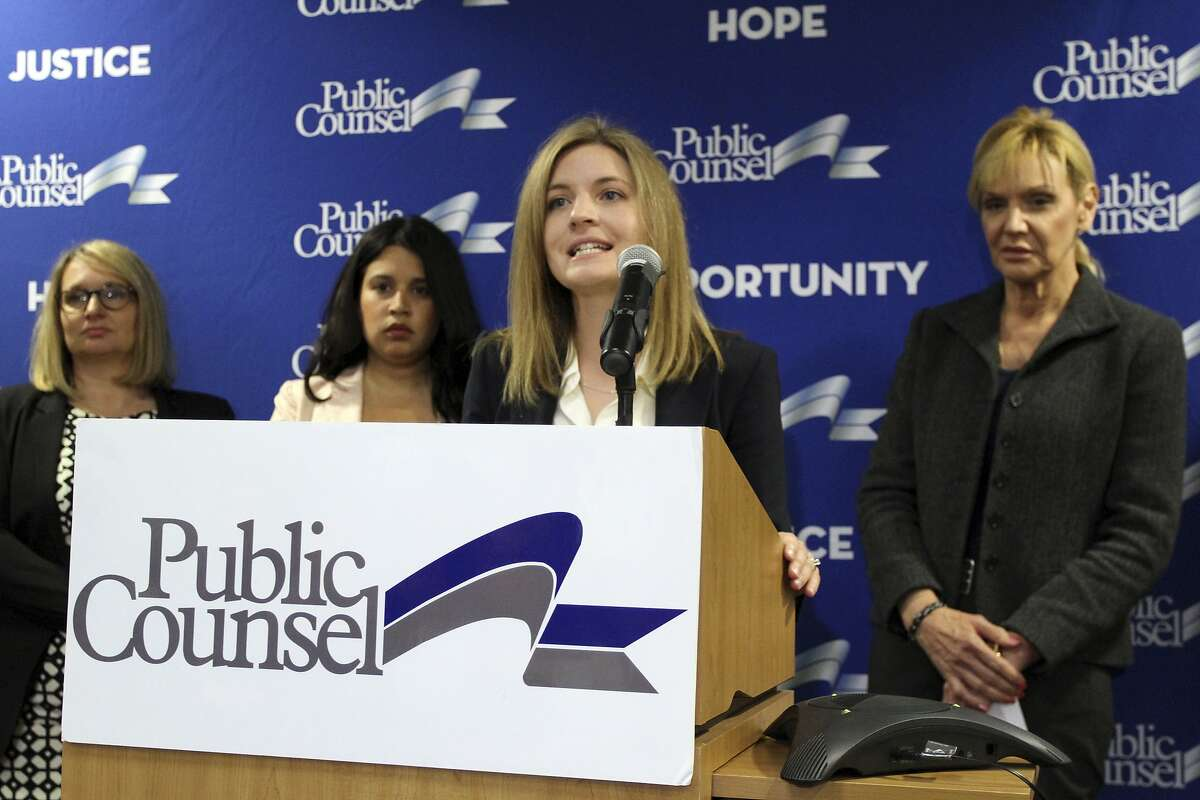 Kathryn Eidmann, a staff attorney at Public Counsel, at podium, speaks at a news conference announcing a lawsuit alleging systemic gender discrimination in the California workers' compensation system on Wednesday, July 6, 2016, in Los Angeles. At right is one of the plaintiffs, Janice Page, a California sheriff's sergeant. The lawsuit claims California's workers' compensation system discriminates against women by judging benefits on the basis of stereotypes and ignoring harm done to women, such as refusing benefits when a woman loses a breast to cancer. The suit filed Wednesday on behalf of several women and a labor union argues that women's equal opportunity rights are violated. (AP Photo/Amanda Lee Myers)
