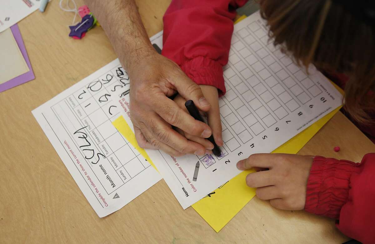 Special Education teacher George Keller helps a student with a counting worksheet during the last class of the extended school year for special education students at Sunset Elementary School July 6, 2016 in San Francisco, Calif.