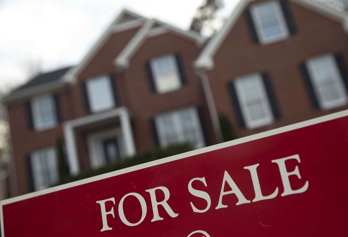 FILE - This Thursday, Dec. 3, 2015, file photo shows an existing home for sale in Roswell, Ga. On Wednesday, April 20, 2016, the National Association of Realtors reports on sales of existing homes in March. (AP Photo/John Bazemore, File)