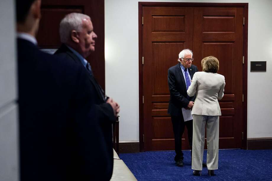 Sen. Bernie Sanders (I-Vt.) and House Minority Leader Nancy Pelosi (D-Calif.) confer at the Capitol building in Washington, July 6, 2016. Many of Sanders� most fervent supporters seethed with disappointment at the FBI�s announcement that they would not be recommending charges over Hillary Clinton�s emails. (Zach Gibson/The New York Times) Photo: ZACH GIBSON, NYT