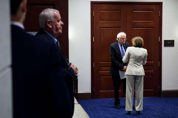Sen. Bernie Sanders (I-Vt.) and House Minority Leader Nancy Pelosi (D-Calif.) confer at the Capitol building in Washington, July 6, 2016. Many of Sanders� most fervent supporters seethed with disappointment at the FBI�s announcement that they would not be recommending charges over Hillary Clinton�s emails. (Zach Gibson/The New York Times)