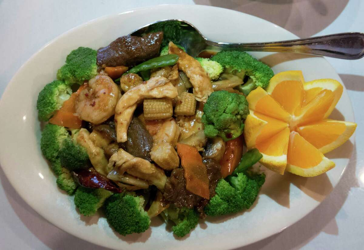 The Triple Delight with chicken, beef, shrimp and veggies, is a popular dish at House of Joy, winner of the 2016 Readers' Choice for Chinese Food.