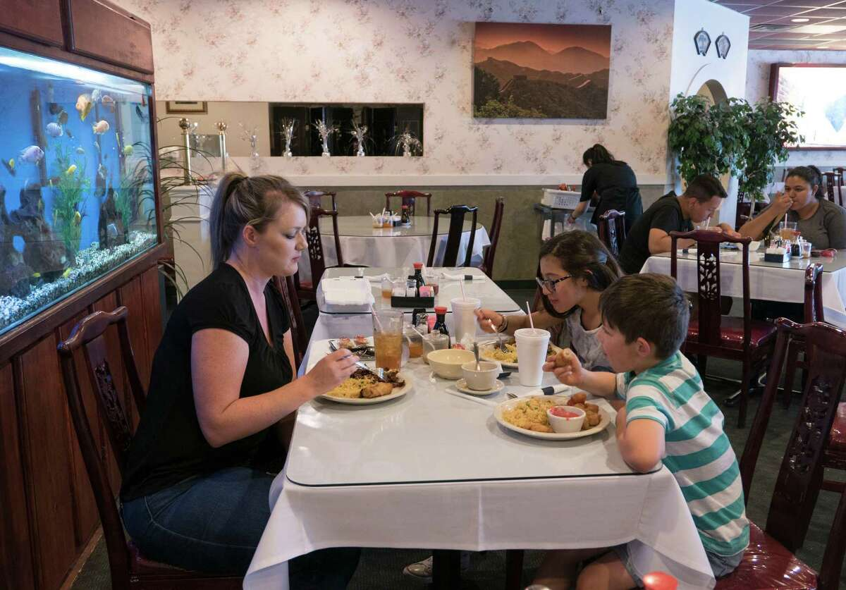 Jennifer Martinez and her children, Blake and Mia, enjoy lunch at House of Joy, winner of the 2016 Readers' Choice for Chinese Food.
