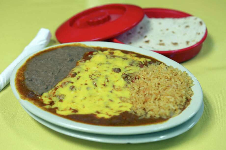 Enchiladas from The Original Blanco Cafe are from a family recipe. Photo: William Luther / Express-News / © 2016 San Antonio Express-News