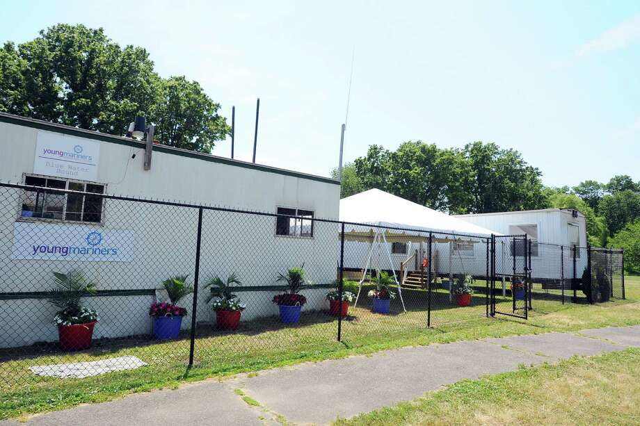 Three trailers, one of which is 27 feet oversized, sit in Boccuzzi Park on Monday, June 20, 2016. The largest of the three trailers needs to be removed and replaced with a more appropriately sized trailer. Photo: Michael Cummo / Hearst Connecticut Media / Stamford Advocate