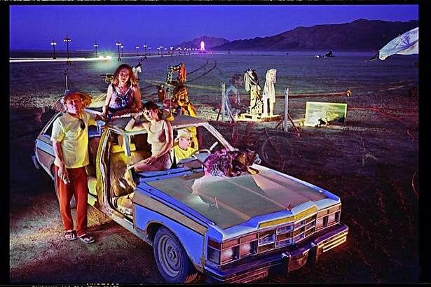 "William Binzen's ""Cerberus and the Styx Shift,�photograph from Burning Man, 1996""�(shot on medium format film; archival pigment print 43 x 54)."