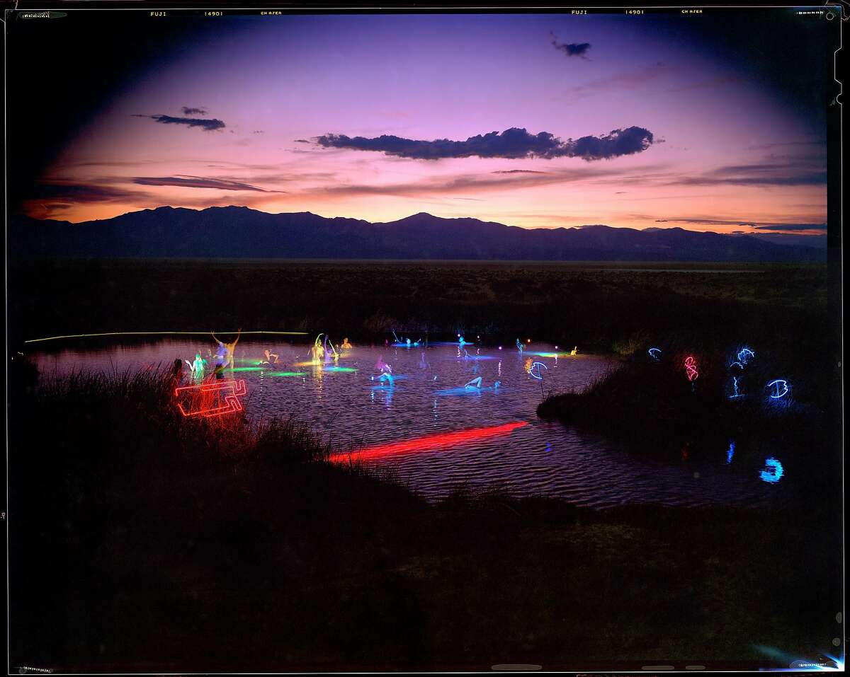 """William Binzen's """"Black Rock Hot Springs-Blessed by Water Sprites and Submerged Neon-Commencing Desert�Siteworks, 1992""""�(shot on 8 x 10 film; archival pigment print 24 x 30)."""