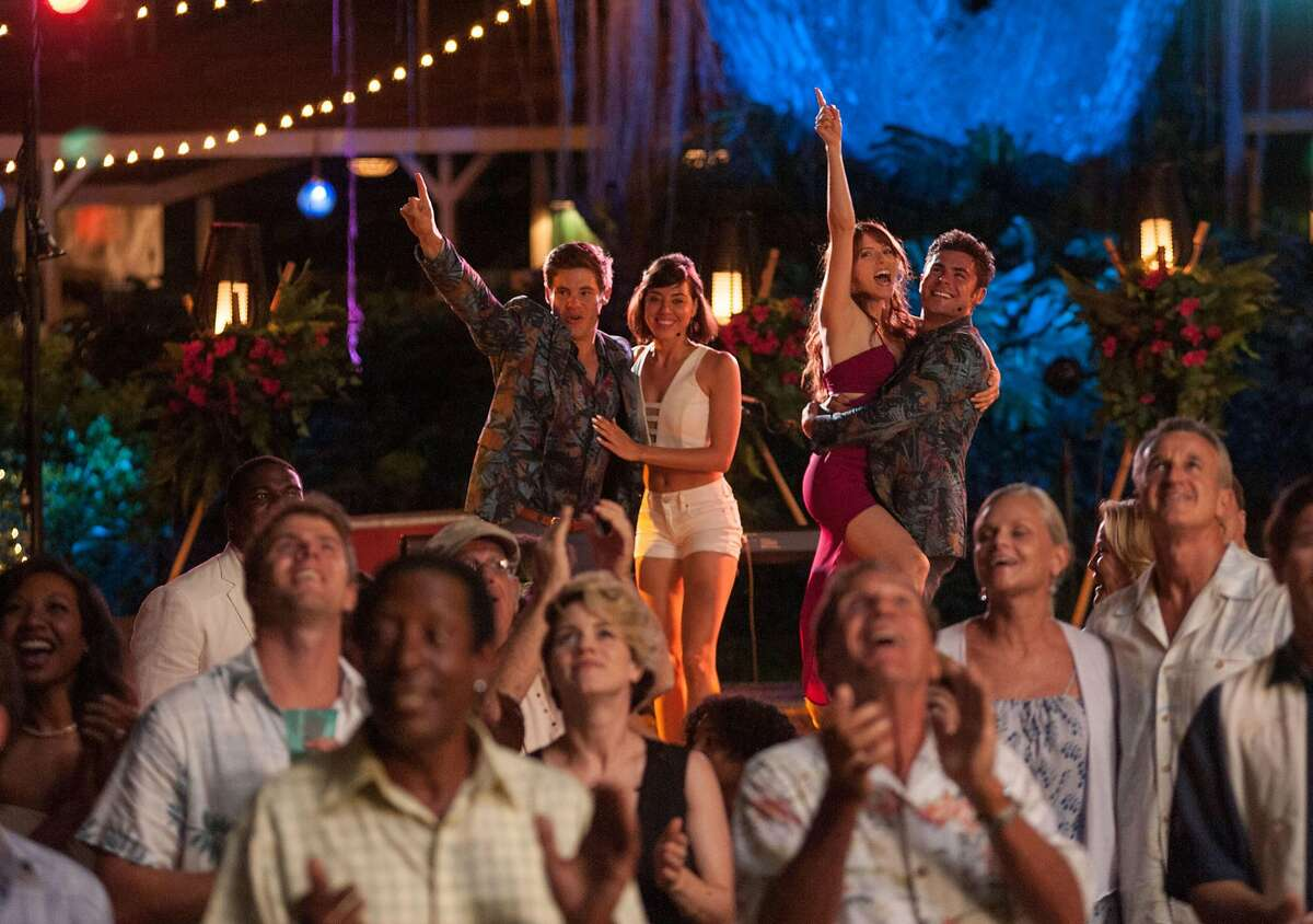 """In this image released by 20th Century Fox, from left, Adam Devine, Aubrey Plaza, Anna Kendrick and Zac Efron appear in a scene from the film, """"Mike and Dave Need Wedding Dates."""" (Gemma LaMana/20th Century Fox via AP)"""