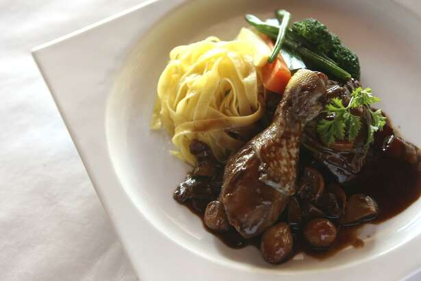 The coq au vin at Chez Vatel Bistro, which readers and our critic deemed the best French food in the city.