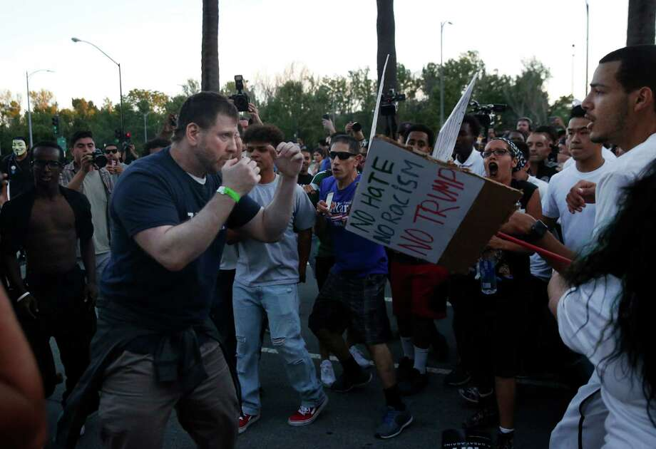 A Donald Trump supporter gets in a fighting position after getting in a tiff with anti-Trump protesters after they surrounded him and snatched his hat off of his head near the convention center where presidential candidate Donald Trump held a campaign rally June 2, 2016 in downtown San Jose, Calif. Photo: Leah Millis, Staff / Leah Millis/ The Chronicle