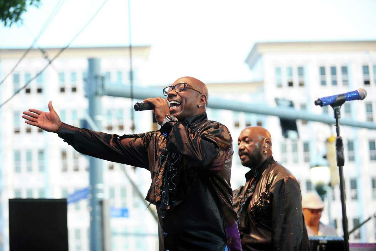The Temptations' Larry Briggs sings during Stamford's first Wednesday Nite Lite concert of the summer at Columbus Park on Wednesday, July 6, 2016.