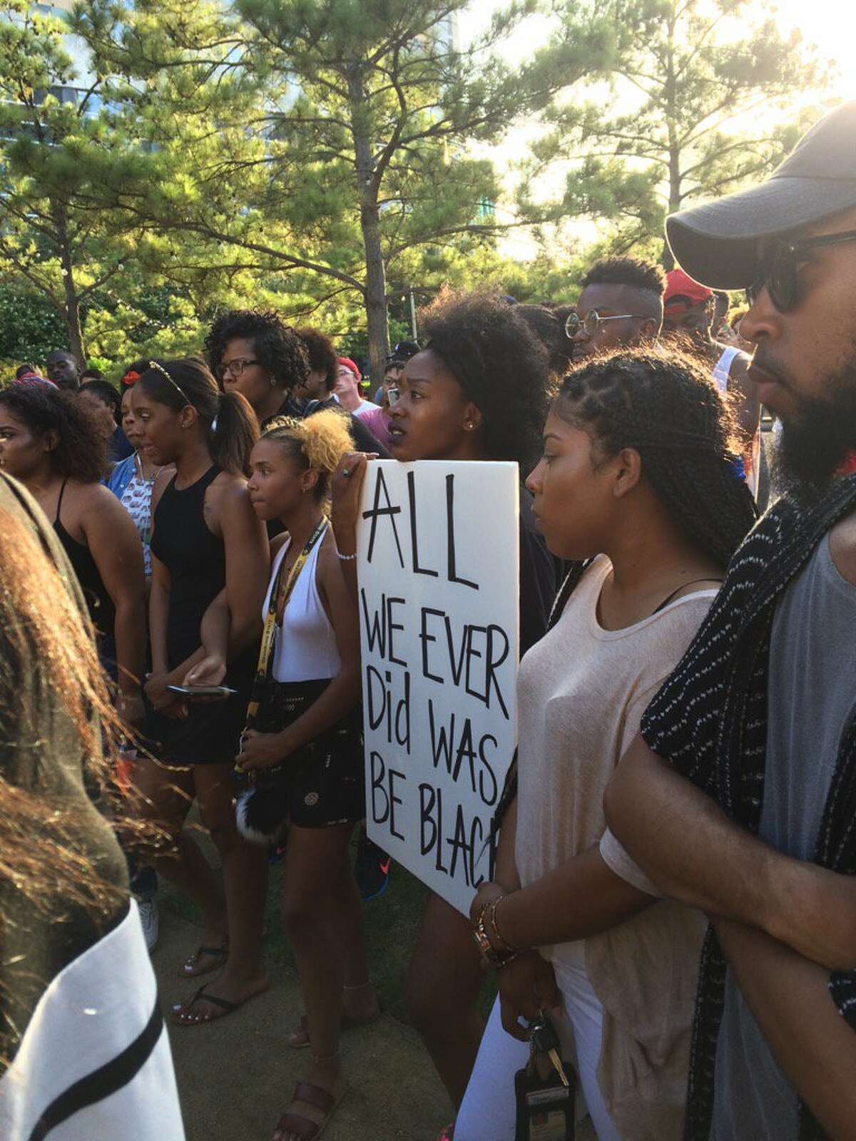 About 150 people gathered at Discovery Green in Houston on Wednesday at an event that denounced the police killing of Alton Sterling in Baton Rouge, La.