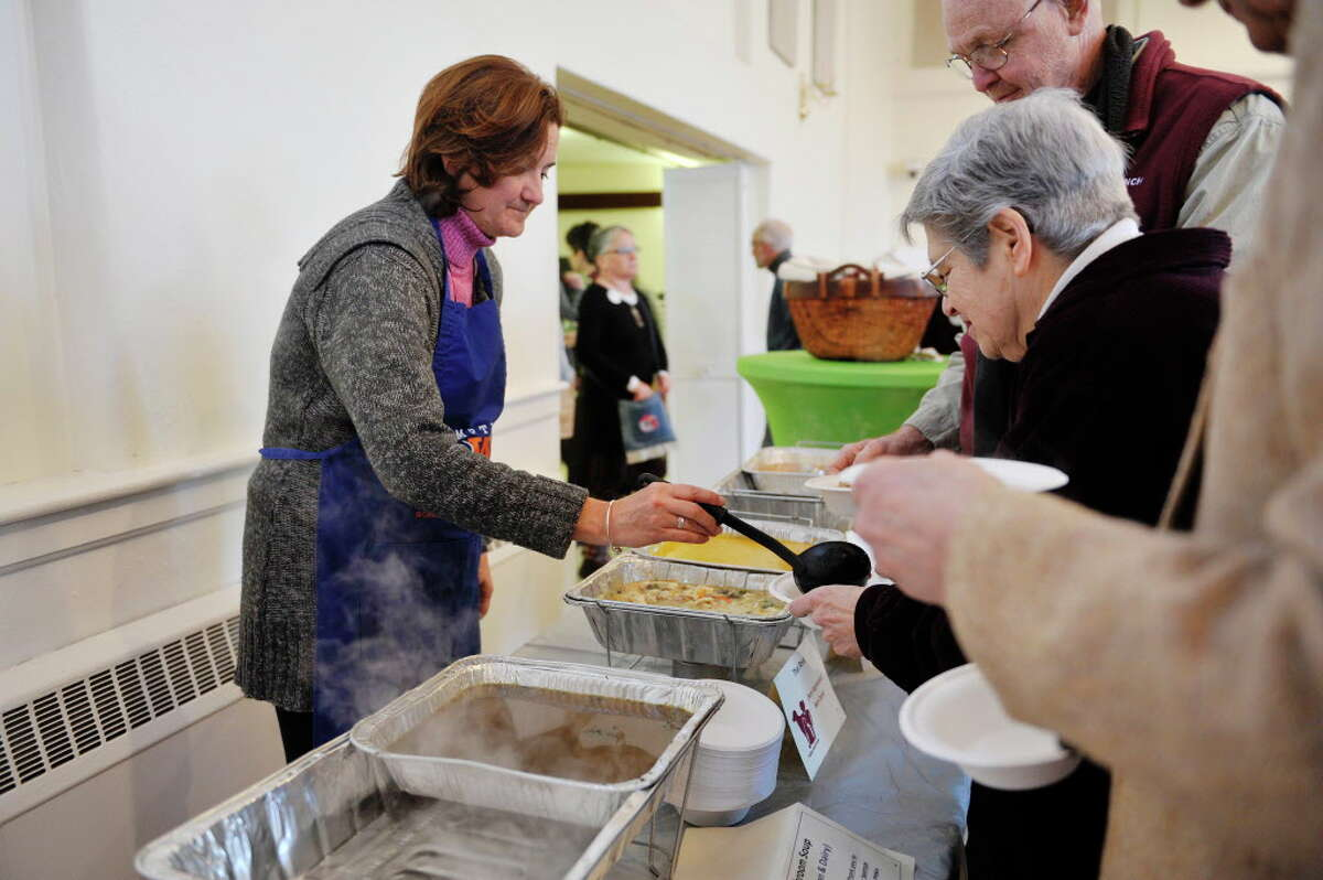 Volunteer Lori Harris dishes out soup at the Empty Bowls Anti-Hunger event put on by the FOCUS Churches of Albany and Hunger Action Network of New York State in Albany. (Paul Buckowski / Times Union)