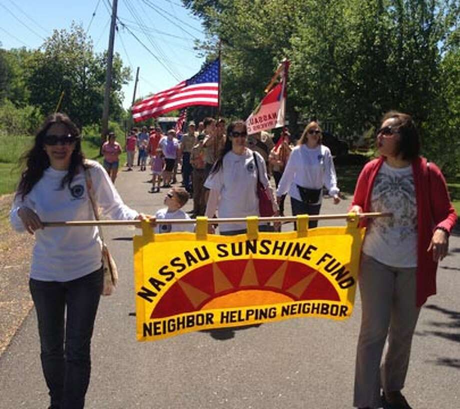 Members of the nonprofit Nassau Sunshine Fund spread their message about neighbors helping neighbors during a recent parade. (Nassau Sunshine Fund)