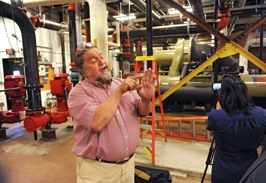 Philip Morris, CEO of Proctor's, explains the water heating and cooling system for its building and 26 other nearby businesses while in the cooling level at Proctor's on Wednesday, July 6, 2016 in Schenectady, N.Y. (Lori Van Buren / Times Union) Photo: Lori Van Buren / 20037246A