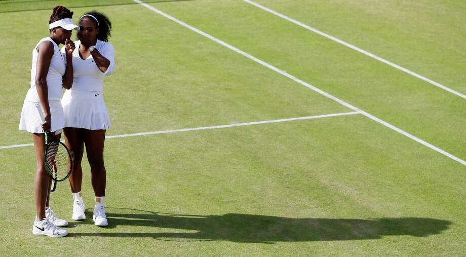 Venus Williams, left, and Serena Williams of the U.S speak during their women's doubles match against Andrea Hlavackova and Lucie Hradecka of the Czech Republic on day nine of the Wimbledon Tennis Championships in London, Tuesday, July 5, 2016. (AP Photo/Kirsty Wigglesworth) ORG XMIT: WIM282 Photo: Kirsty Wigglesworth / Copyright 2016 The Associated Press. All rights reserved. This m