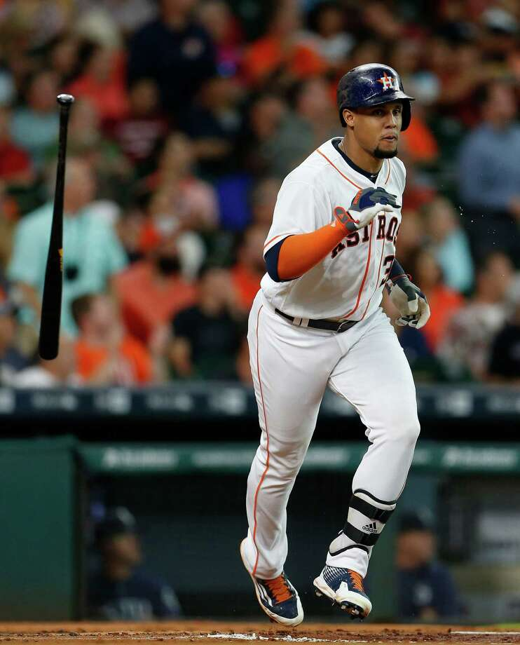 Houston Astros center fielder Carlos Gomez (30) flips his bat after hitting his RBI double during the first inning of an MLB baseball game at Minute Maid Park, Wednesday, July 6, 2016, in Houston. Photo: Karen Warren, Houston Chronicle / © 2016 Houston Chronicle